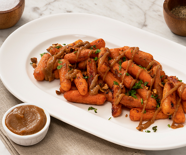 Honey Dijon Apple Butter Glazed Carrots with Hazelnuts